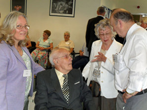 Photo of members chatting at the reunion
